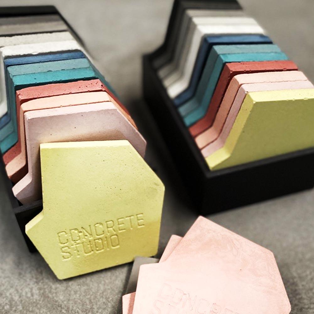 A stack of Concrete Studio concrete colour samples
