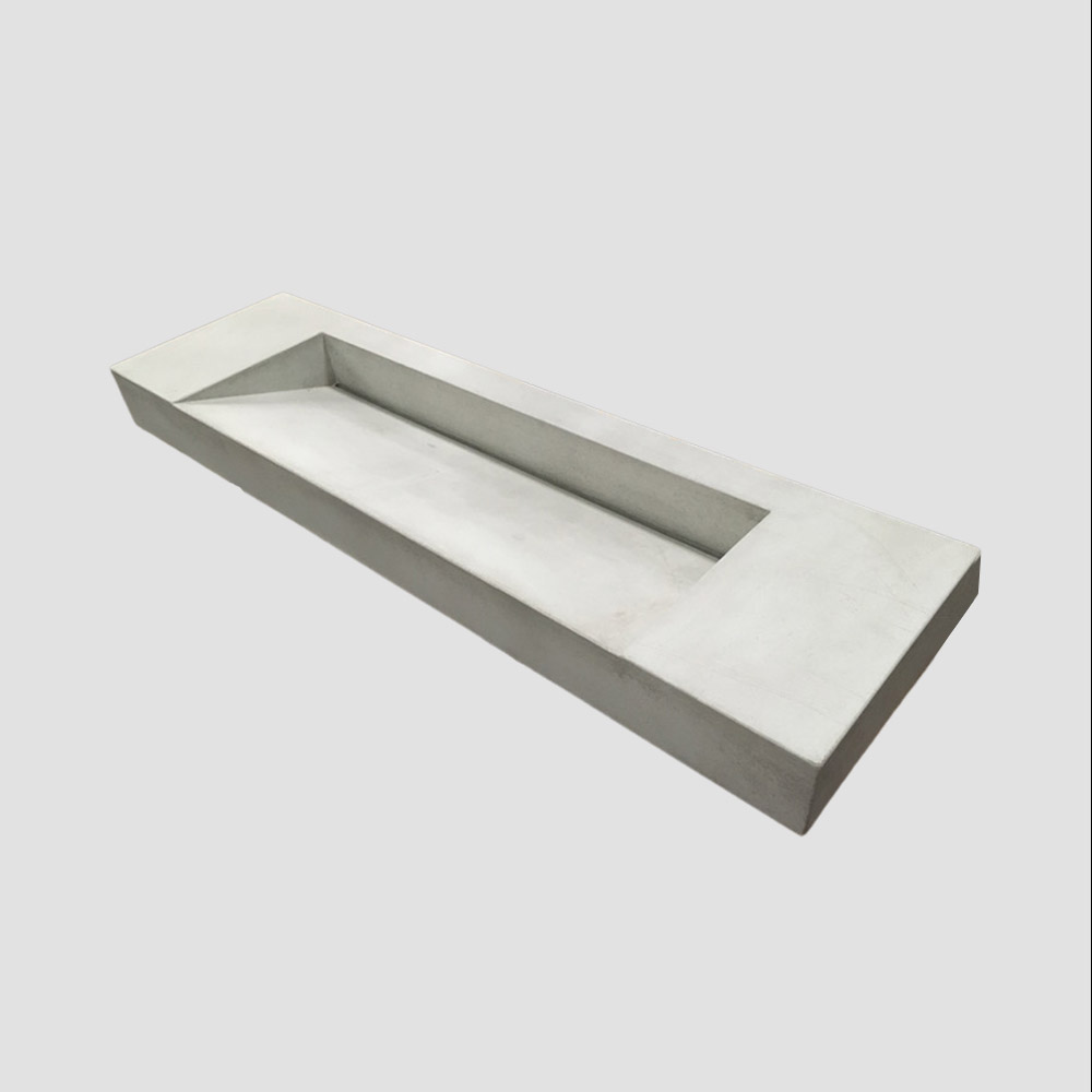 A sloping concrete ramp sink with slope towards rear drainage - The Ramp by Concrete Studio