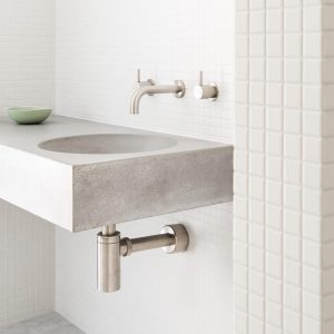 A wall hung concrete sink with wall taps - Bowl by Concrete Studio