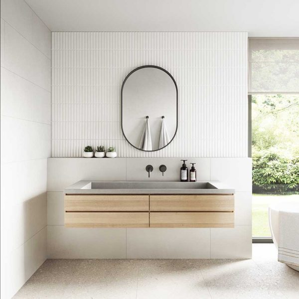 A concrete Ramp Sink installed on a timber bathroom cabinet - by Concrete Studio