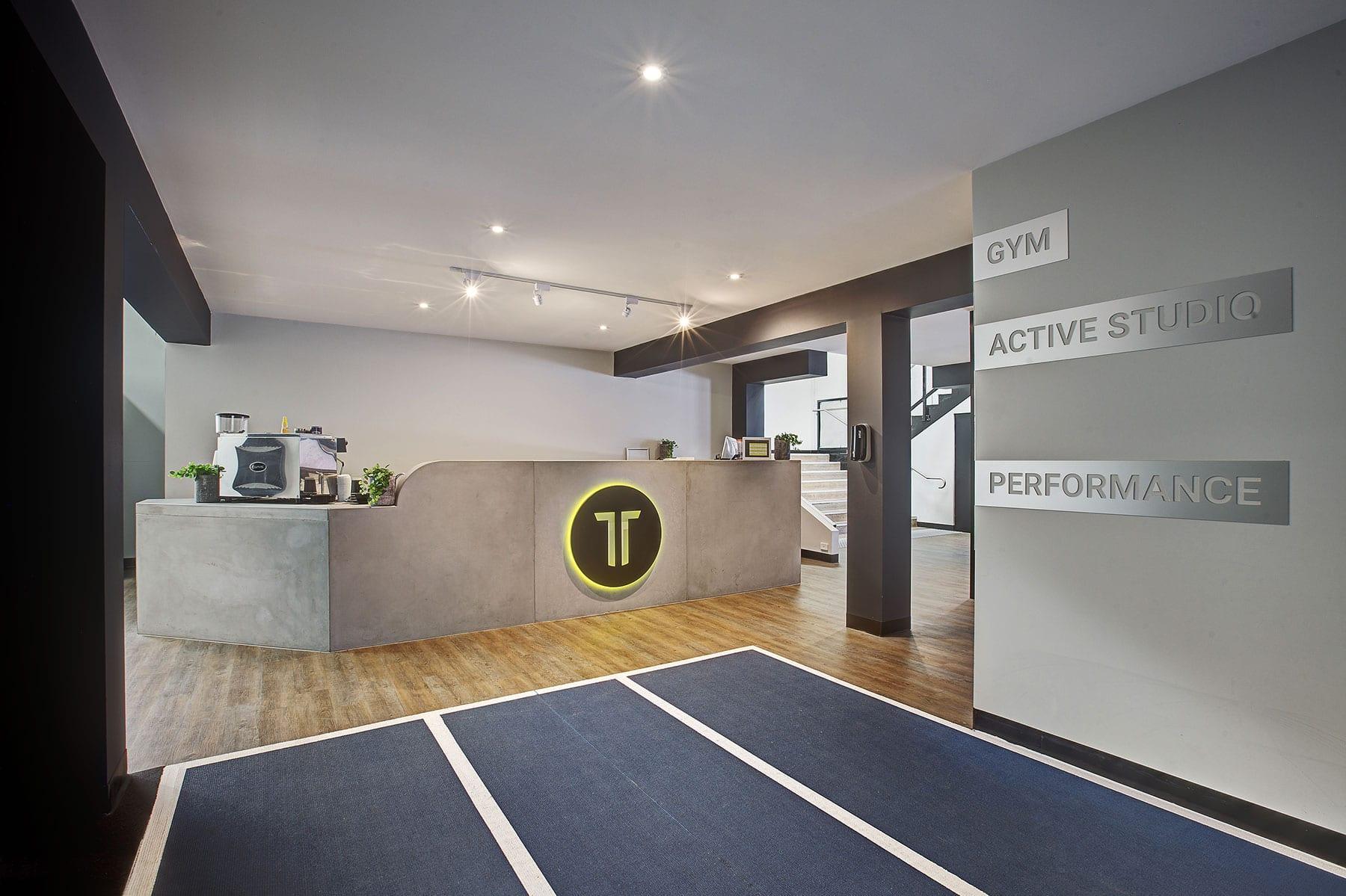 Concrete Reception Desk and Fascia at Tempus Gym by Concrete Studio
