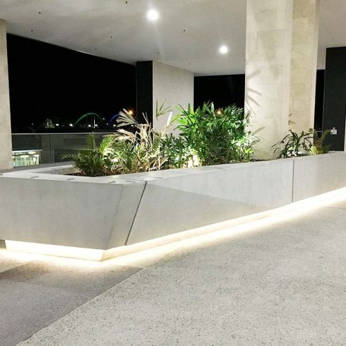 Feature Concrete Planter and Concrete Street Furniture - fully lit - at Ernst and Young - by Concrete Studio
