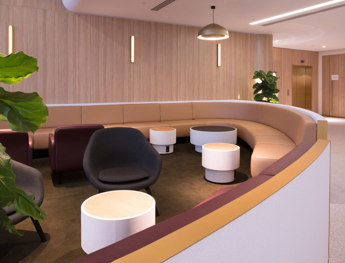 Large concrete indoor tables in the Qantas business class lounge - Concrete Studio