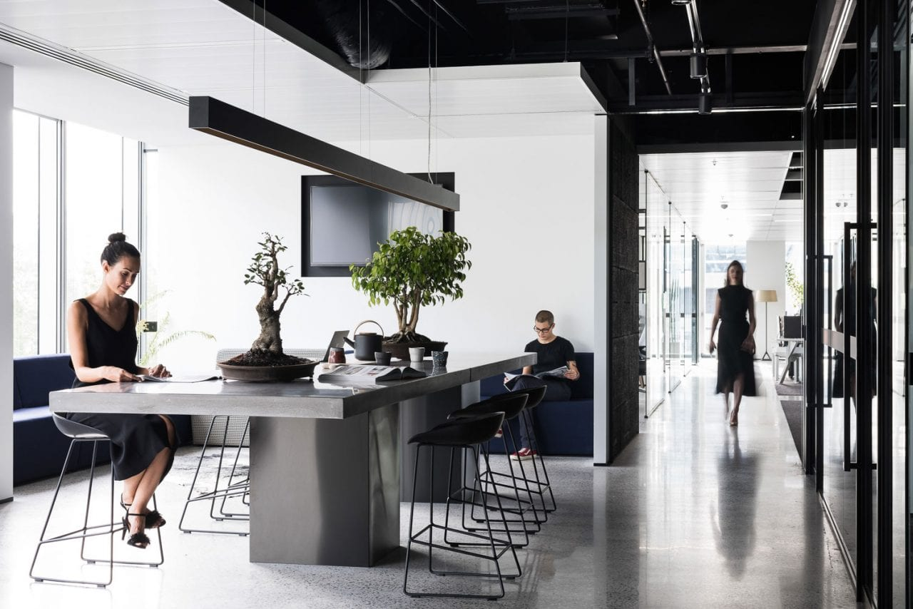 People sitting at a commercial concrete office table - Concrete Studio