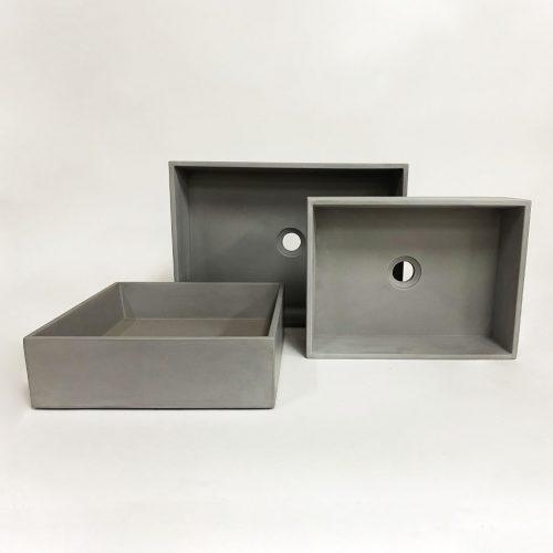 Three Slab Rectangle Concrete Vessel Basins shown upright by Concrete Studio