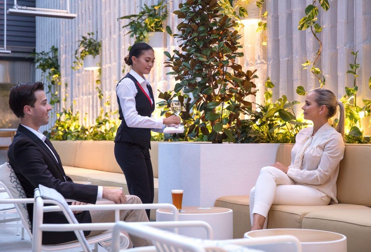 White concrete outdoor tables in the Qantas business class lounge - Concrete Studio