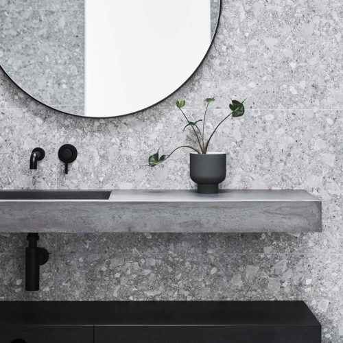 Rectangular Concrete Basin Vanity Top in a modern Simplism bathroom with plant 01 - Baly by Concrete Studio