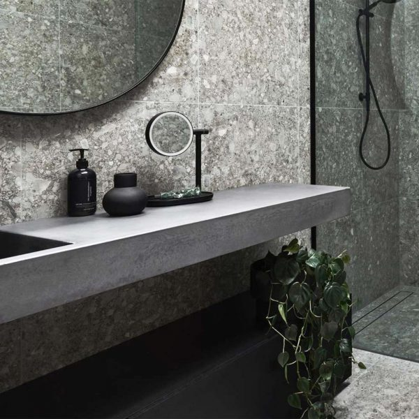 Rectangular Concrete Basin Vanity Top in a modern bathroom with plants - Baly by Concrete Studio