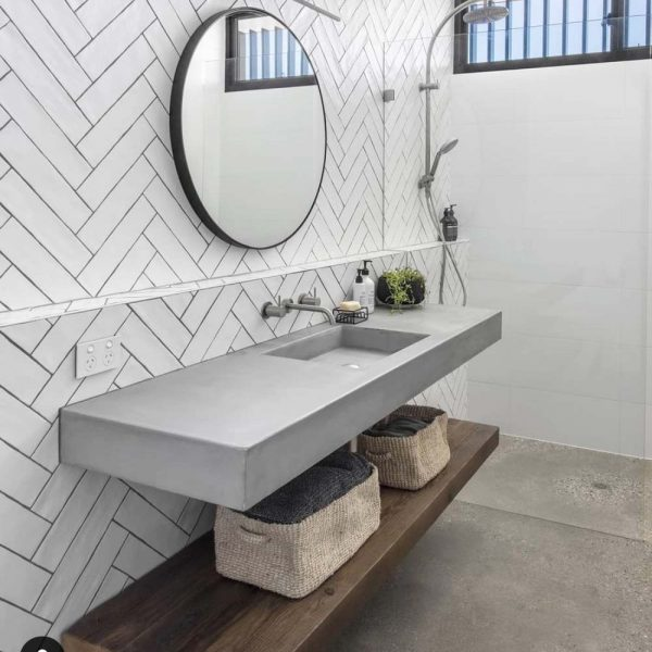 Wall Mounted Concrete Basn with herring bone tiles - by Concrete Studio